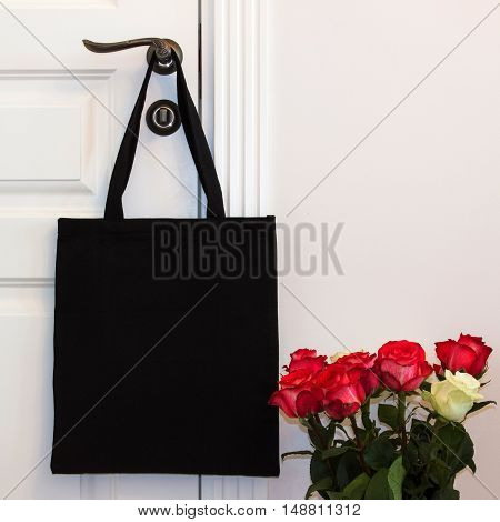 Black cotton eco tote bag design mockup. Handmade shopping bags.