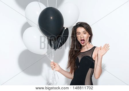 young playful woman posing on white background
