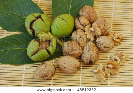 juglans before and after get opened on bamboo mat