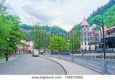 BORJOMI GEORGIA - MAY 27 2016: The central street of resort leads to the sources of the mineral water located in Borjomi Park on May 27 in Borjomi.
