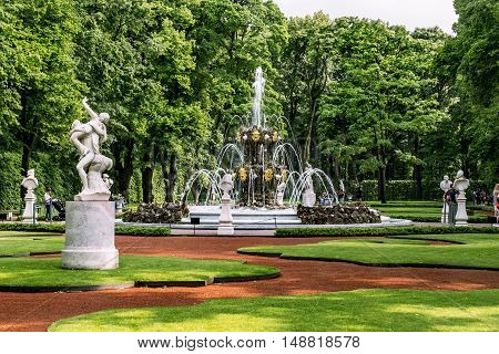 Saint-Petersburg. Russia. June 17 2016. View of working fountain in the Summer garden in St. Petersburg.