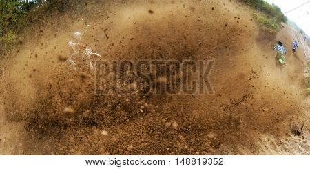 Rider driving in the motocross race on mud track