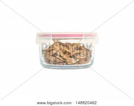 Closeup fried little fish in glass ware isolated on white background with clipping path