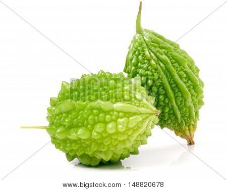 two green bitter melon or momordica isolated on white background.