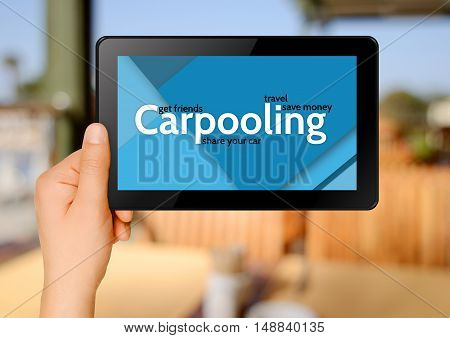 Carpooling concept. Close up of man hands holding tablet pc.