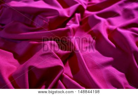 Bed linen shop. Wrinkles on the red silk vail detailed stock image