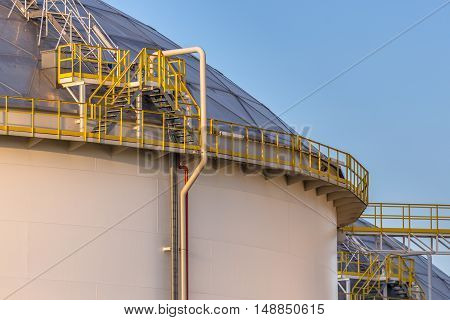 Modern Big Oil Storage Tanks With Detail Of Steps And Stairs