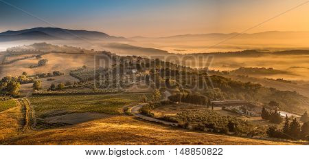 Sunrise With Fog Over Tuscan Village