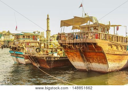 Dubai, United Arab Emirates - May 3, 2013: close up of traditional wooden fishing boats docked on Bay Creek.The creek divides the city into two main sections Deira and Bur Dubai old downtown of Dubai.