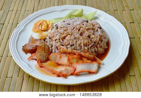 barbecued red pork dressing sweet sauce on brown rice