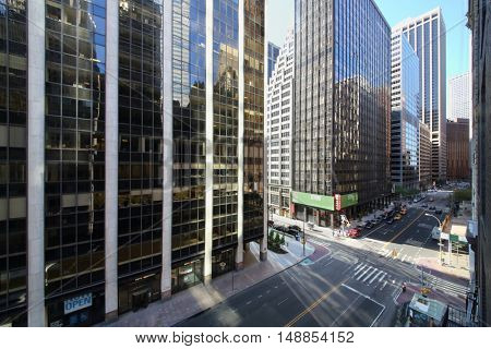 NEW YORK, USA - SEP 07, 2014: Crossroads of Wall Street and Water Street near skyscrapers in New York