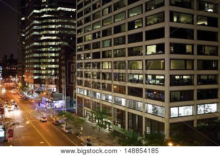 NEW YORK, USA - SEP 07, 2014: Building One Wall Street Plaza on Water Street in the evening, top view