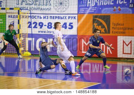 MYTISHCHI, RUSSIA - OCT 16, 2014: Players running for the ball on the Russian Futsal Super League in the Sports Complex Construction in Mytishchi