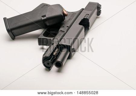 gun 9 mm. with magazine on white background