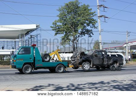 CHIANG MAI, THAILAND - JANUARY 6 2015:  SayThong Tow truck for emergency car move. Photo at road no 1001 about 8 km from downtown Chiangmai, thailand.