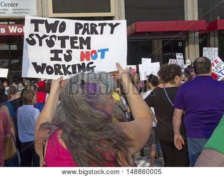 Asheville, North Carolina, USA: September 12 2016: Woman at a Donald Trump campaign rally holds a sign saying