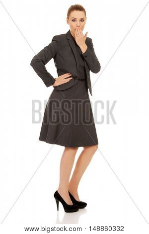 Business woman giggles covering her mouth with hand