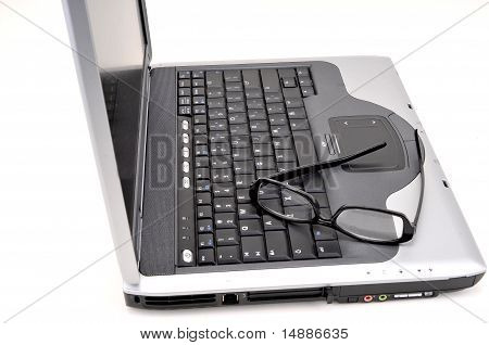 Open laptop with black glasses