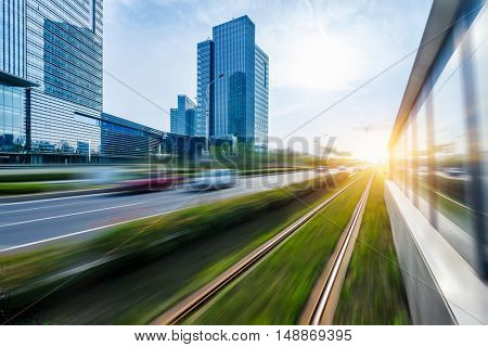 cityscape with road traffic and railroad track,suzhou,china,asia.