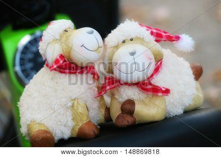 White cute sheep dolls background. Cute sheep dools