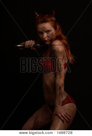 Dark Red Devil Girl With A Knife