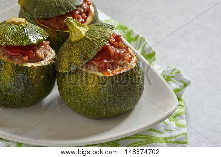 Eight-Ball zucchini stuffed with meat and rice