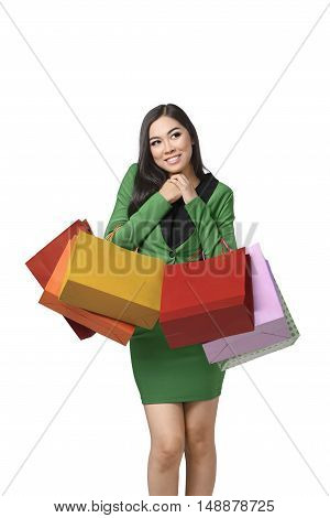 Beautiful Asian Woman Holding Shopping Bags And Smiling