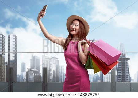 """Smiling Asian Woman Shopping Outdoor Taking A """"selfie"""" Or Self Portrait"""