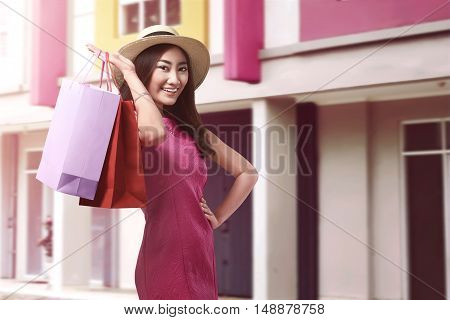 Smiling Asian Woman With Shopping Bags