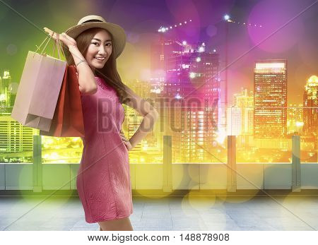 Happy Shopping Asian Woman With Shopping Bags