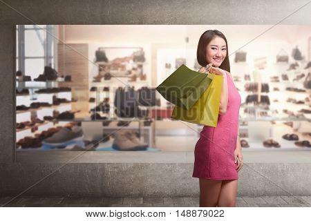 Young Asian Woman With Shopping Bags Walking