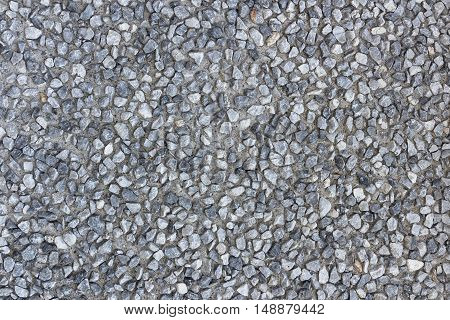 Hard surface of small pebble concrete. Texture with a lot of small stones for your background.