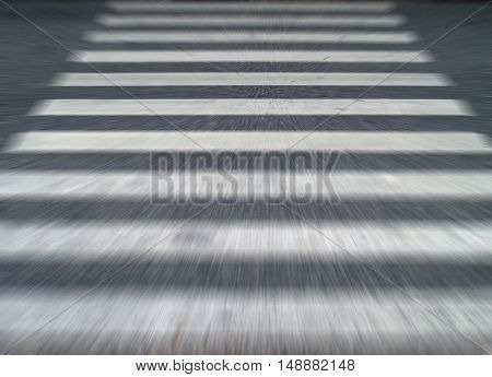 running across the crosswalk blurred motion background, concept about panic feel when faced with scary things