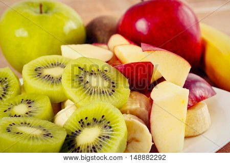 Fresh whole and sliced fruit close up gently toned