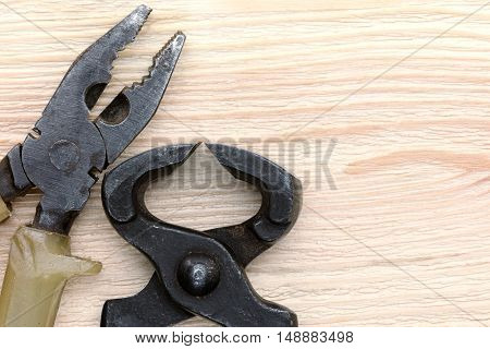 Old Pincers And Pliers On Wooden Table Background, Hand Tools