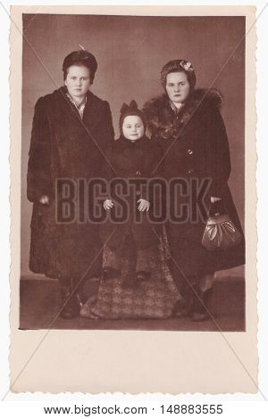 VITEBSK BELARUS - CIRCA 1956: Group growth portrait of two young women with child (vintage photo 1950s)