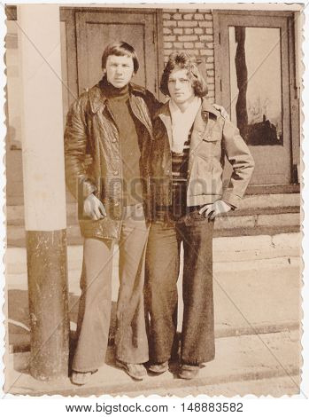 SENNO BELARUS - CIRCA 1977: Group growth portrait of two young men on school porch (vintage photo 1977th year)