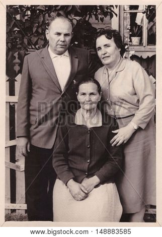 VITEBSK BELARUS - CIRCA 1965: Family portrait of elderly woman and her brother with his wife (vintage photo 1965)