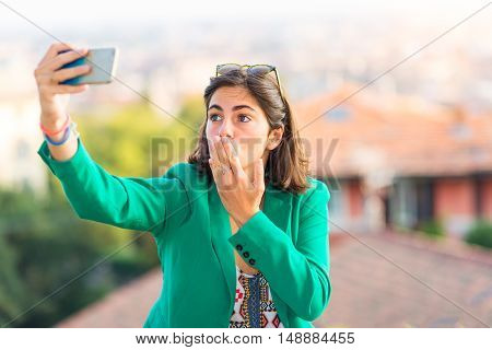 Young Beautiful Girl Taking Sends A Kiss Away Selfies With Mobile Phone