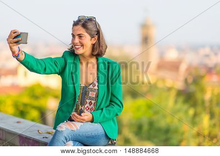 Young Beautiful Smiling Girl Taking Selfies With Mobile Phone