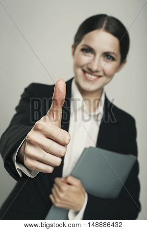 Businesswoman Making Thumbs Up Sign Isolated Face Blur