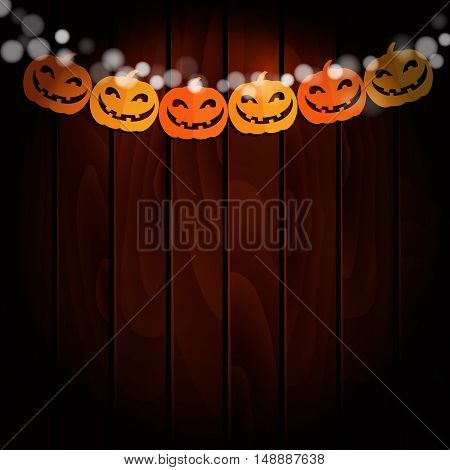 Halloween greeting card invitation. Party decoration string of paper pumpkins handmade cut paper flags. Old wooden background. Vector illustration.