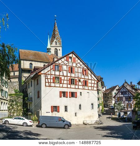 BADEN,SWITZERLAND - AUGUST 26,2016 - City church and timberd house in Baden. Baden is located on the left bank of the river Limmat.