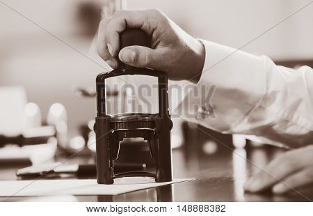 Notary public in office stamping document. Retro style