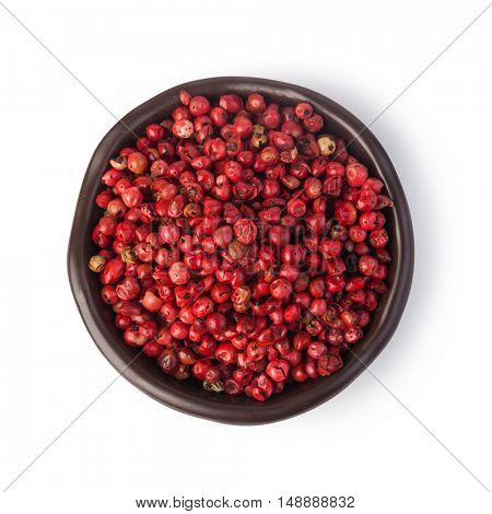 pink pepper on white background