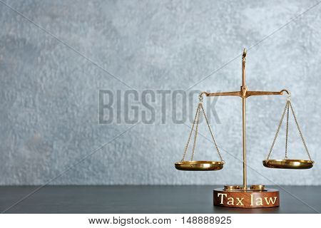 Law scales on a table. Tax law concept