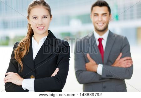 Business partners smiling in an urban setting