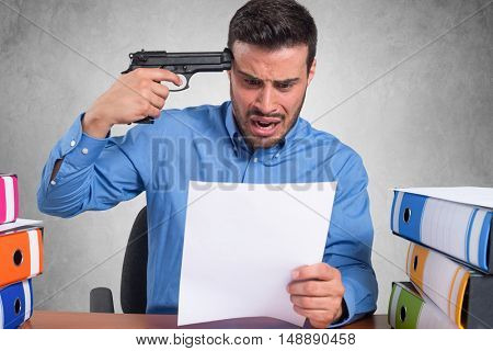 Businessman pointing a gun to his head