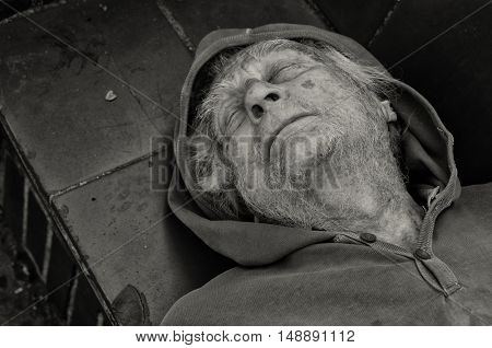 September 16th,2016 Los Angeles,California. Sad senior Man sleeping on the street in Downtown Los Angeles.