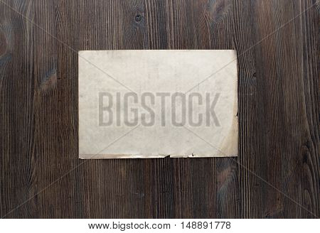 white paper on old wooden background